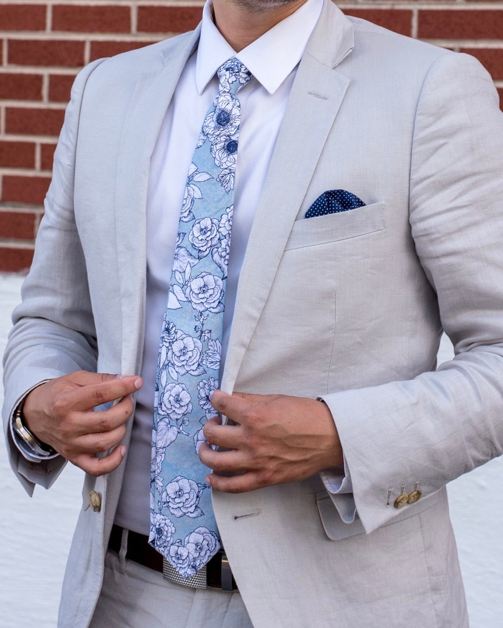Man wearing a suit with a floral tie - Blue and white floral pattern tie - Oxford Square