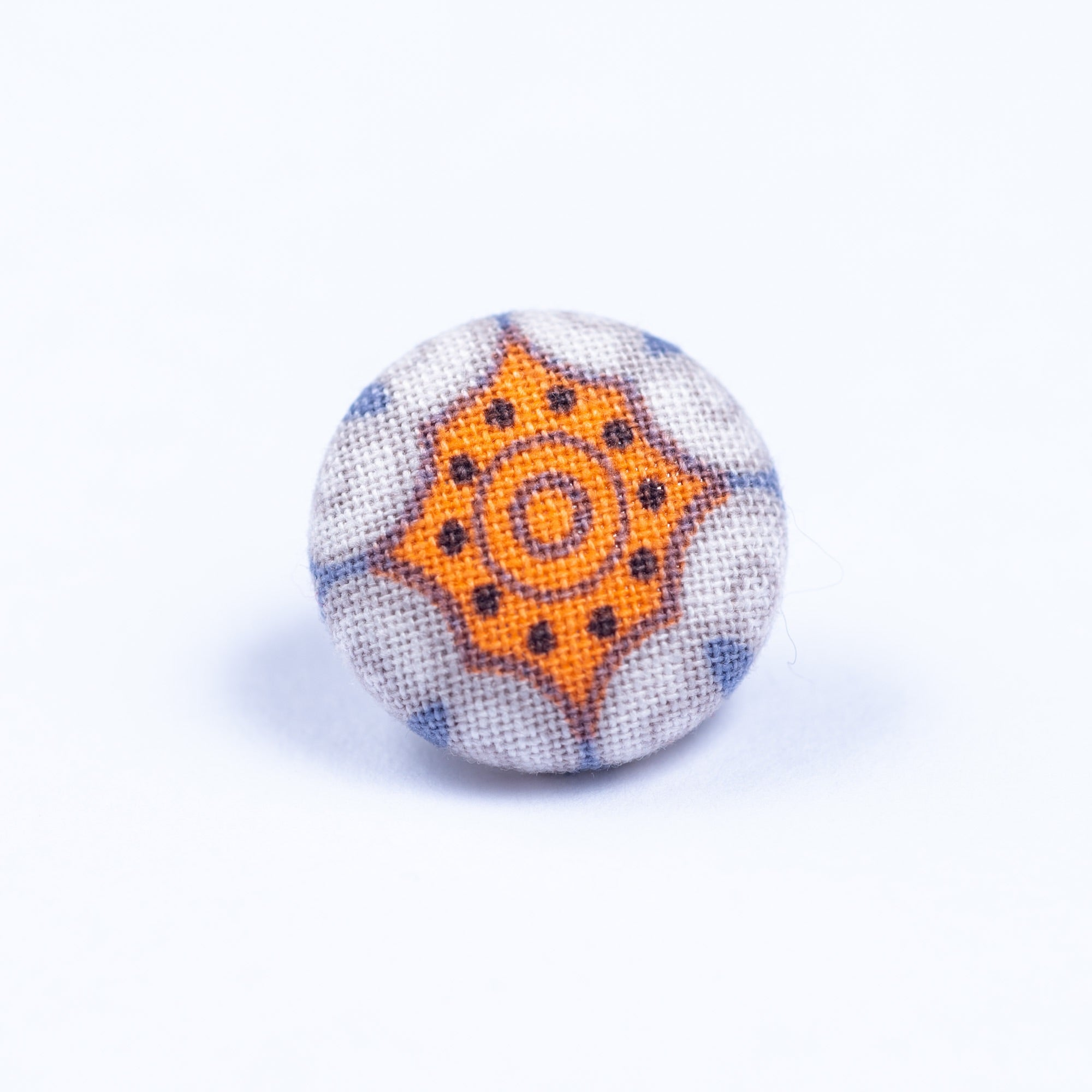 orange and white lapel pin - Oxford Square
