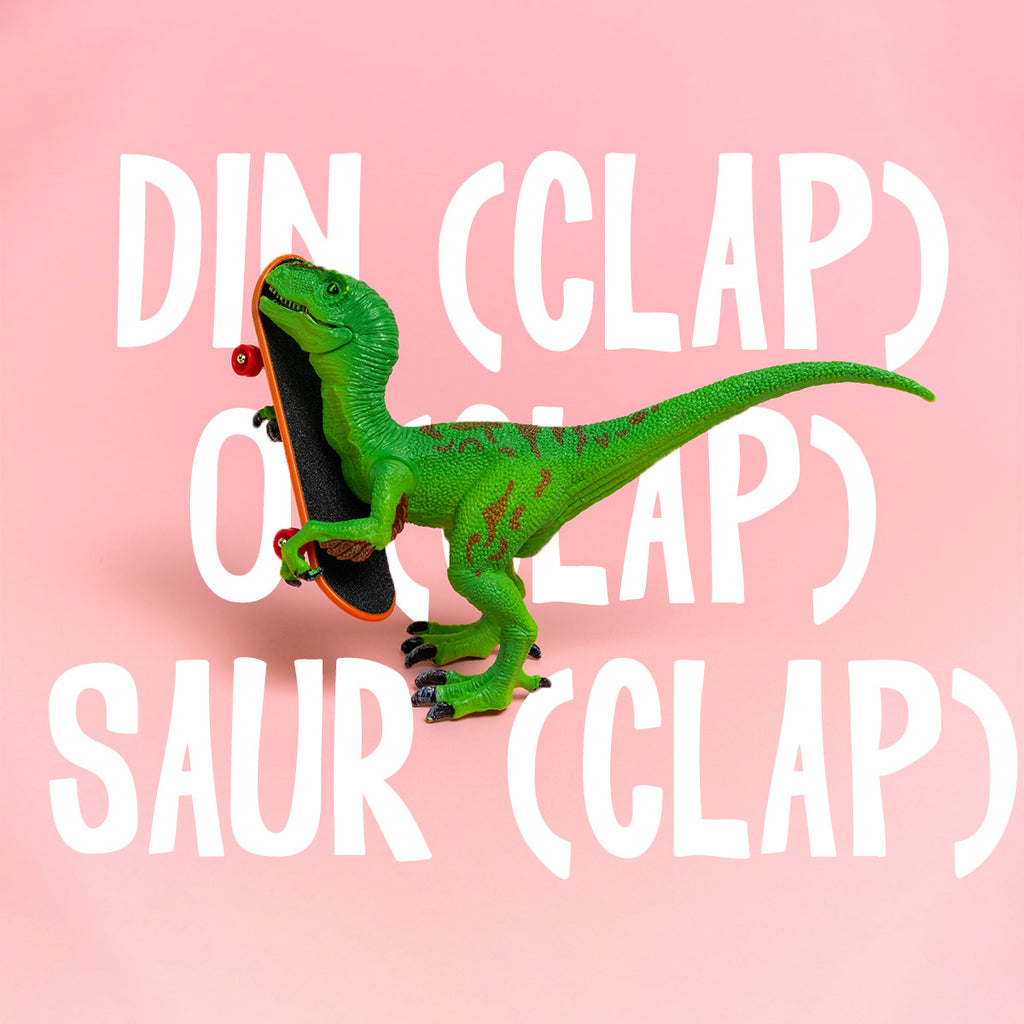toy green dinosaur holding a skateboard. syllable spelling example