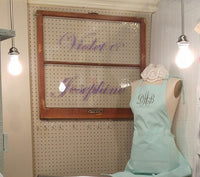 Violet & Josephine: The Embellishment Bar.  Where we make everything personal.  This vintage window sign introduces Violet and Josephine.  The monogrammed apron is just a small taste of the personalization we can do.