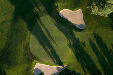 aerial view of golf green with bunkers and sand