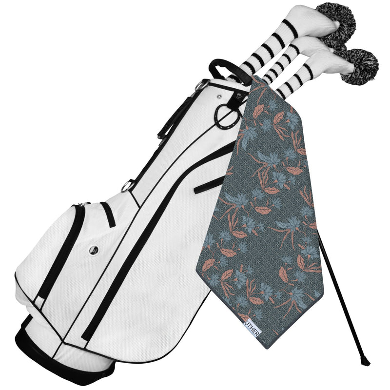 Fashionable Waffle Texture Microfiber Golf Towel complete with clip. The dark pattern with the light leaves is an elegant look. It's a great golf accessory to add to your game!