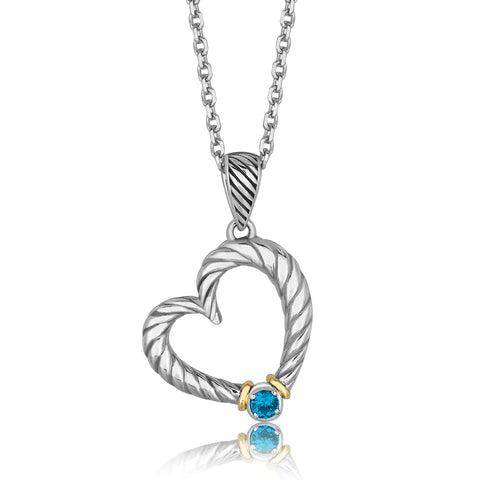 Distinctive Luxury London Style 18K Yellow Gold and Sterling Silver Heart Style Pendant with a Blue Topaz