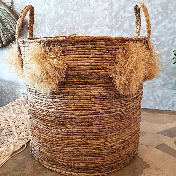 Natural Woven Banana Leaf Round Basket With Grass Pom-Poms - Canggu & Co