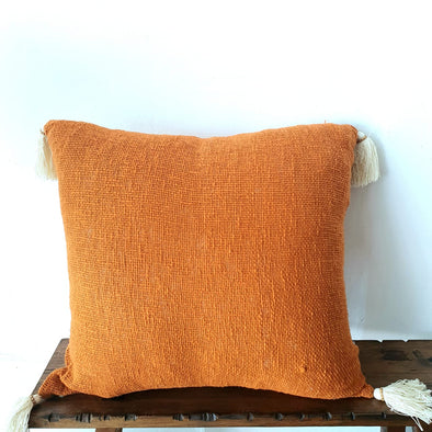 Orange Colored Raw Cotton Cushion With Tassels