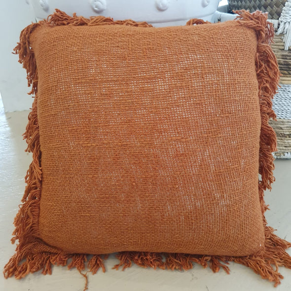 Various Orange & Rust Colored Raw Cotton Cushions With Fringe