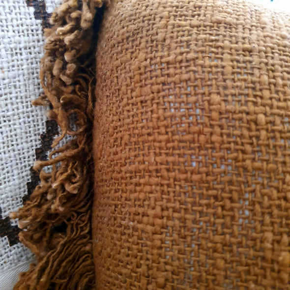 Various Brownish Colored Raw Cotton Cushions With Fringe