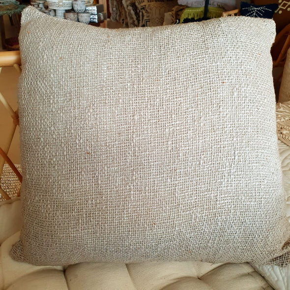 Various Silverish Colored Raw Cotton Cushions With Fringe