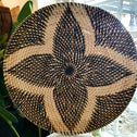 Small Woven Rattan Plates With Flower Motifs