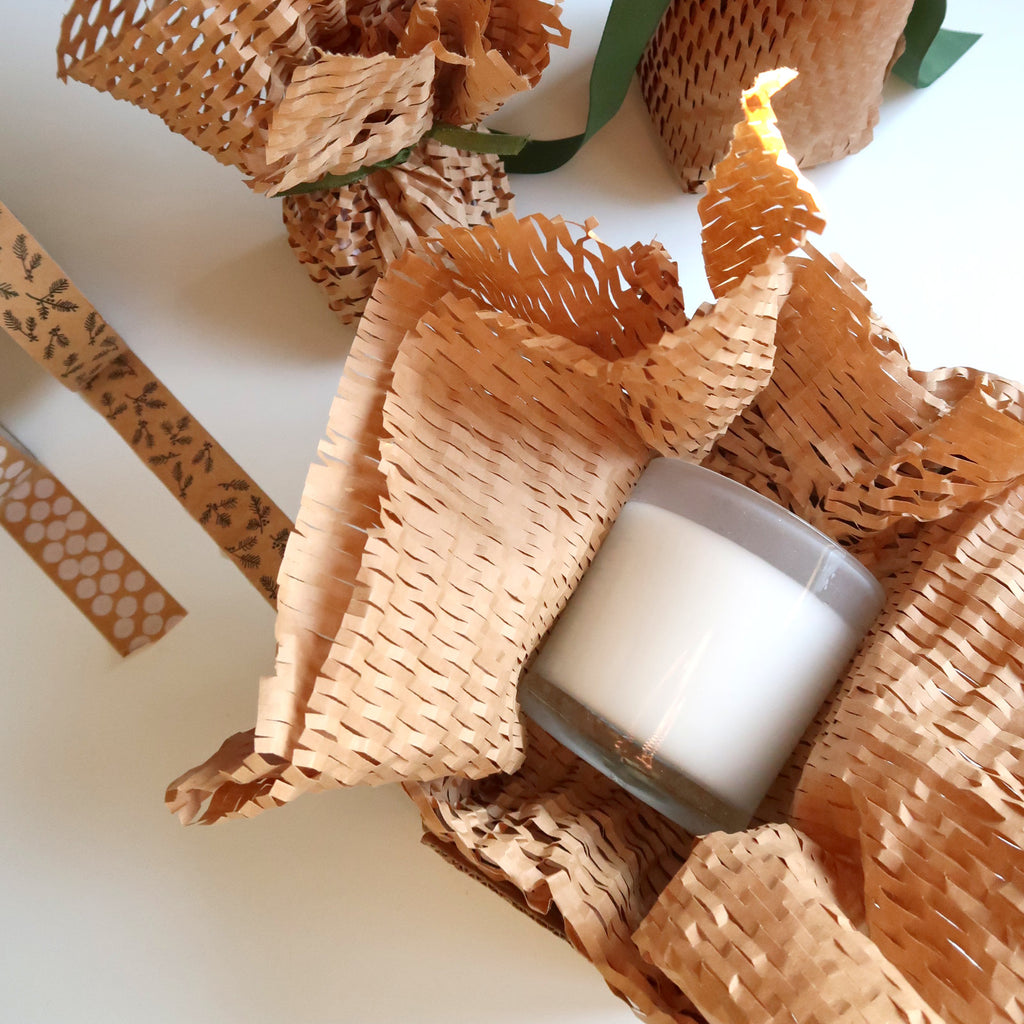 candle wrapped in honeycomb protective packaging