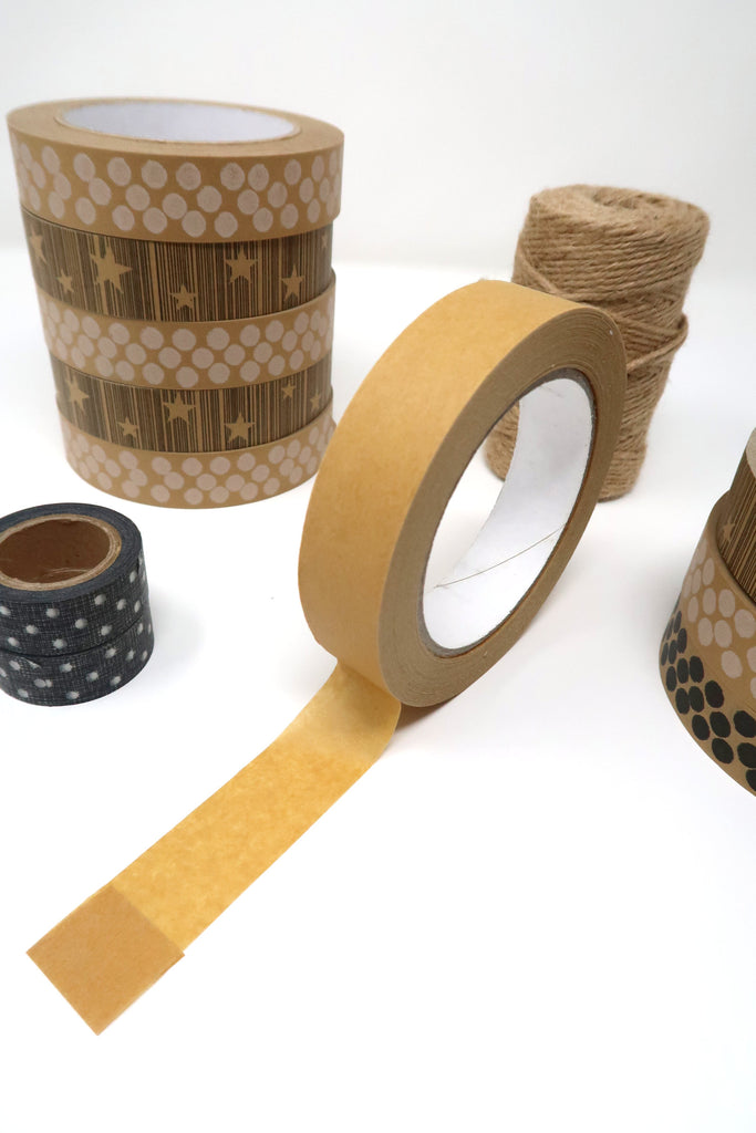Roll of Kraft paper tape with rolls of printed tape and jute string