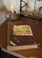 19th Century Book with Farm Scene mural by Jonathan D Poor and tin candleholder