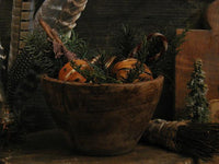 Primitive old Wooden Bowl with Cloved Oranges and Christmas Greens