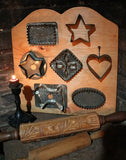 Cookie Cutters Early Display on Pine Board Neat