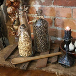 Primitive Riser with Three Old Glass Bottles and Wooden Spoon Gathering