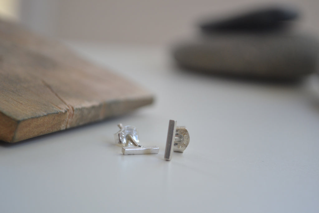 Dash stud earrings, sterling silver, close-up