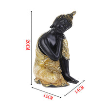 Beautiful Black Buddha Tathagata Statue in Elegant Sitting Pose Draped in Golden Robes