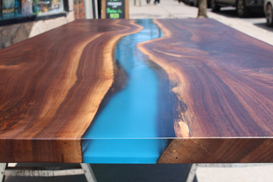Black Walnut river table with blue resin