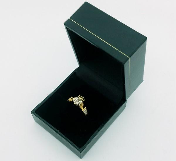 gold claddaph ring in its case