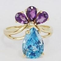 Engagement ring with topaz and amethyst stones