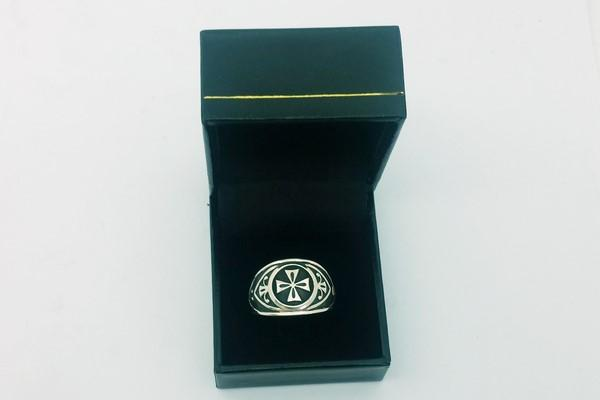 Silver cross signet ring in its case