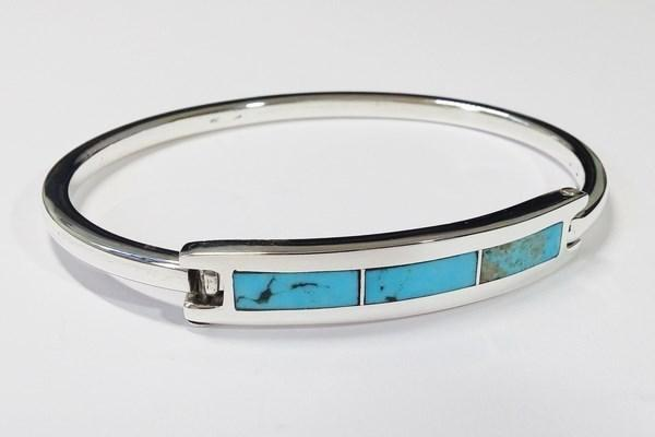 silver bracelet with blue stone