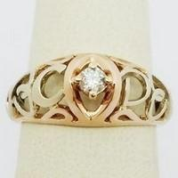 Gold engagement ring with solitary diamond