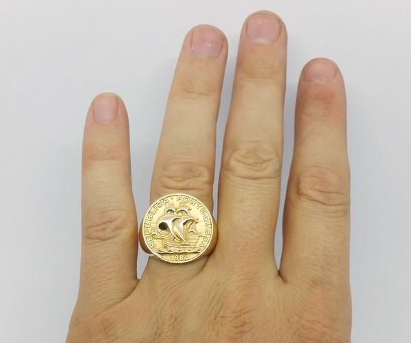large size gold coin ring on ring finger