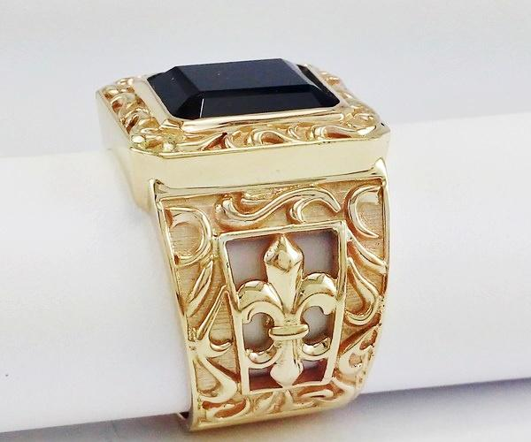 Gold signet ring with fleur de lys and onyx stone