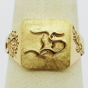 Gold ring with initials engraved in relief