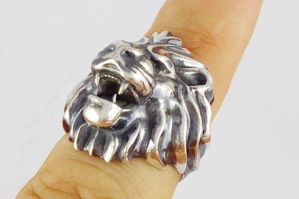 Head Lion ring worn on finger