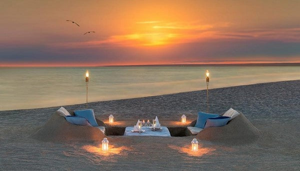 beach private dinner set up for marriage proposal