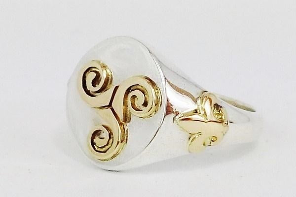 mens celtic ring with gold triskele