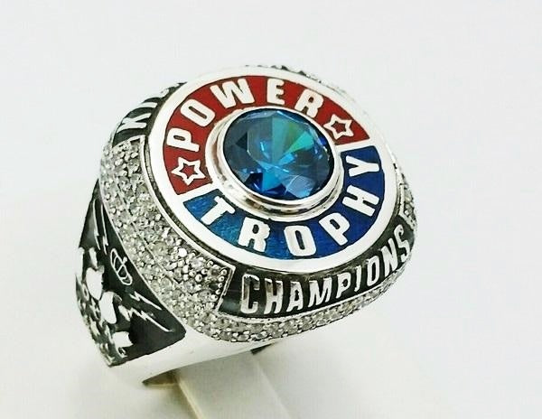 3/4 view of the silver championship ring