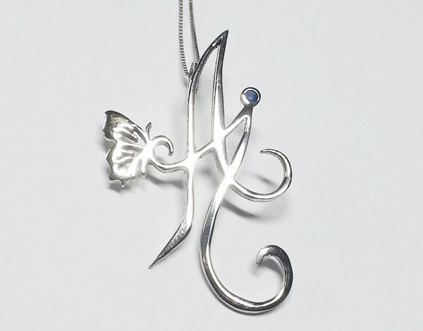 custom made initial pendant in white gold