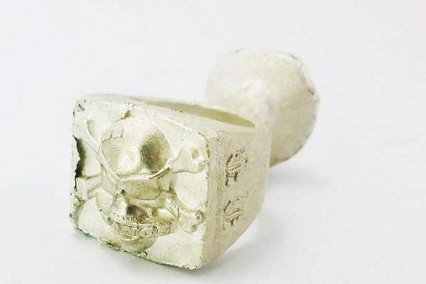 silver casting of the skull biker ring under creation