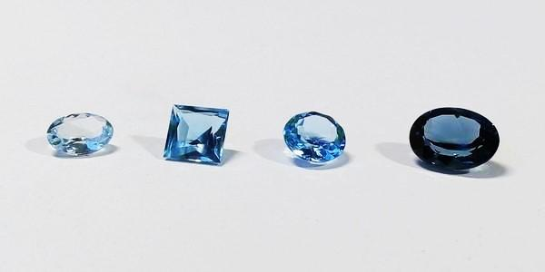different shades of blue topaz stones