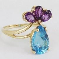 engagement gold ring with blue topaz stone and amethyst stones