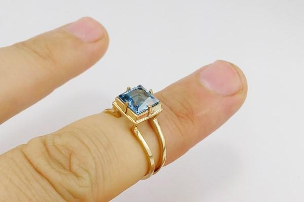 Engagement gold ring with blue topaz stone