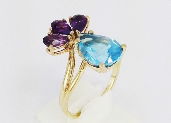 gold engagement ring with topaz stone and 3 amethyst stones