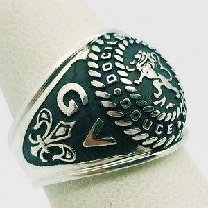 silver signet ring with initials engraved on each side