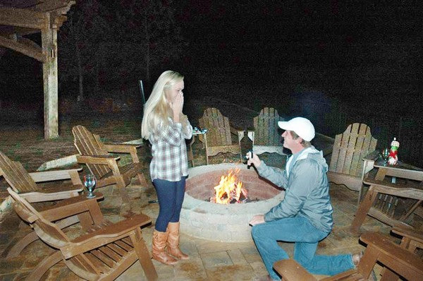 marriage proposal around a firepit outdoor