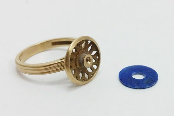 gold ring for women with its lapis lazuli stone on the side before setting