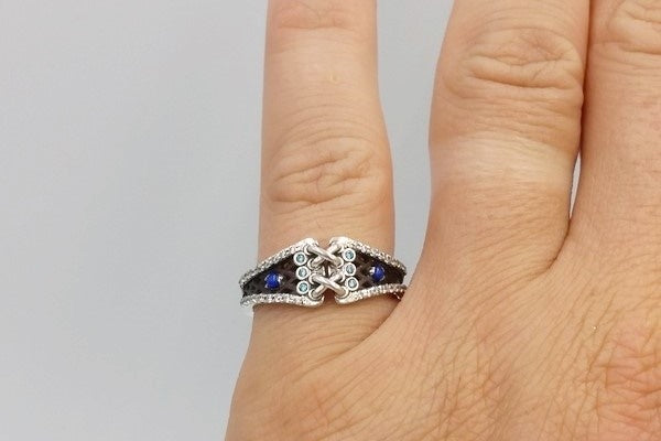 lapis lazuli engagement ring on finger
