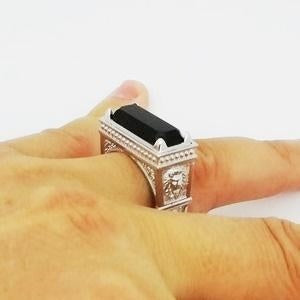 white gold signet ring on the ring finger