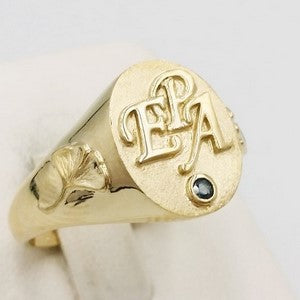 Gold signet ring with initials engraved