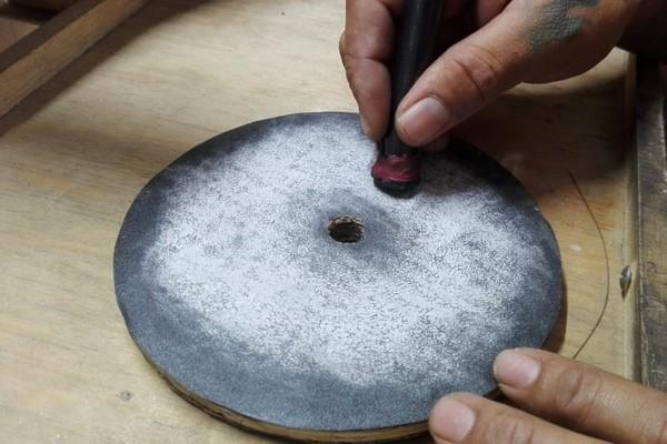 sanding the onyx stone with sandpaper