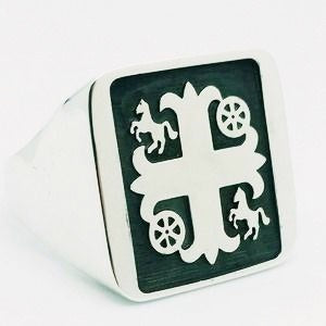 Silver signet ring engraved with family crest