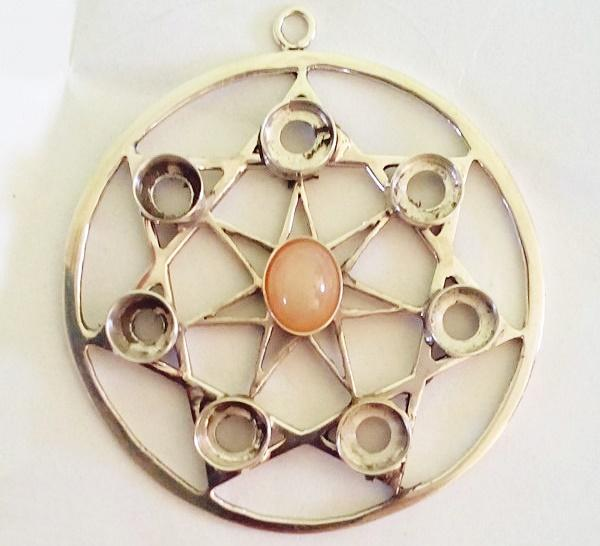 setting moon stone on silver wiccan pendant
