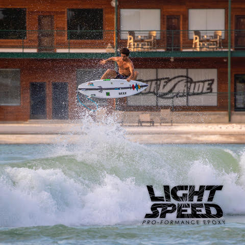 mason ho launching a big air on the driver 2.0 lightspeed by lost surfboards with carbon